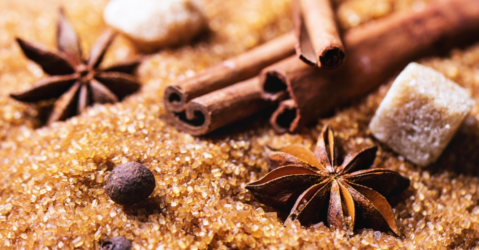 Spices allspice, cinnamon and anise over heap of brown sugar. See series